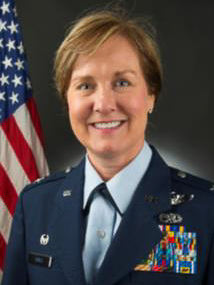 Carla D. Riner, Col, DE ANG.